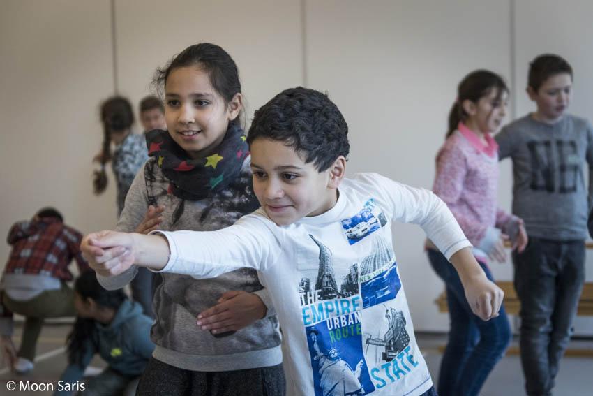 Dansende kinderen bij workshop De Dansers